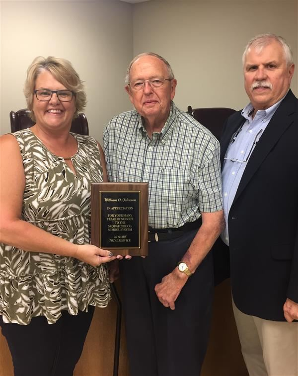 Mr. W.O. Johnson retires with 26 years service as a board member of the Sequatchie County School system.